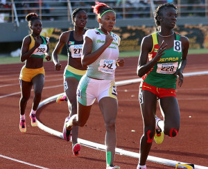 """Tarika """"Tinker Bell"""" Moses makes her move past Grenada's Ariel St. John and into second place in the U20 Girls 800m final"""