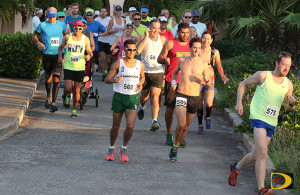 Vincent Fournier, right, leads the field at the start of the 5th Virgin Gorda Half Marathon on Saturday