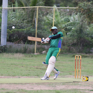 Vincy's Kenrick Leslie drives a four late in the match just before he went LBW off  Reno Mitteholzer's bowling