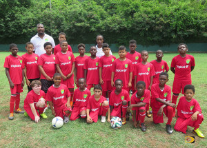"BVIFA Youth Development officer Avondale ""Avon"" Williams and Cassandra ""Cass"" Greg, with young players in the Digicel Center of Excellence at the Millicent Mercer Grounds in Baughers Bay"