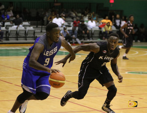 Legs' forward Jason Edwin, right, makes a move past his Kings opposite before dishing out the ball