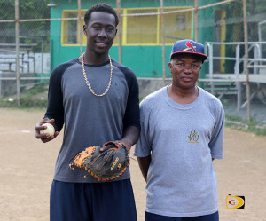 "Shampoy Christopher, left and Terry ""Chino"" Chinnery, who pointed him in the direction of catching as a 4-year old"