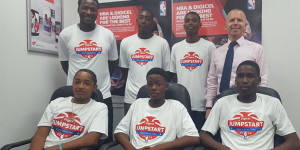 Digicel Brand Ambassador and coach Jason Edwin, top left, with the top players from the Digicel NBA Jumpstart Program