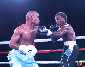 "Julan ""Iron Fist"" Brown, left, uses a left hook against Miguel ""Iron Dog"" Rey to score valuable points during his TKO victory"