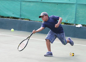 Aiden Brydon, 11, goes for a forehand during his match with Deonte Vanterpool in the U12 Boys Division