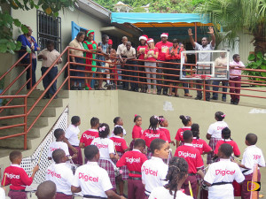 Digicel staff look on as Eslyn Henley Richiez Learning Center students open their presents