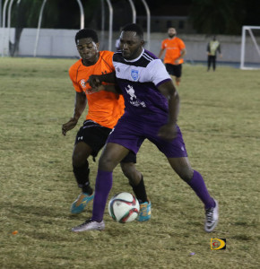 Sugar Boys' Roger Roberts, left shadows Islanders' Francis Pierre during Sunday's President's Cup, which Sugar Boys won, 1-0.