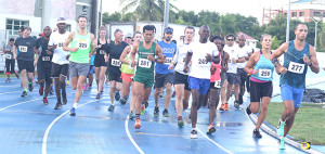 Clif Struiken, far right, sets the pace early en route to winning Saturday's 10th Anniversary Ceres Juices 10K Series kickoff